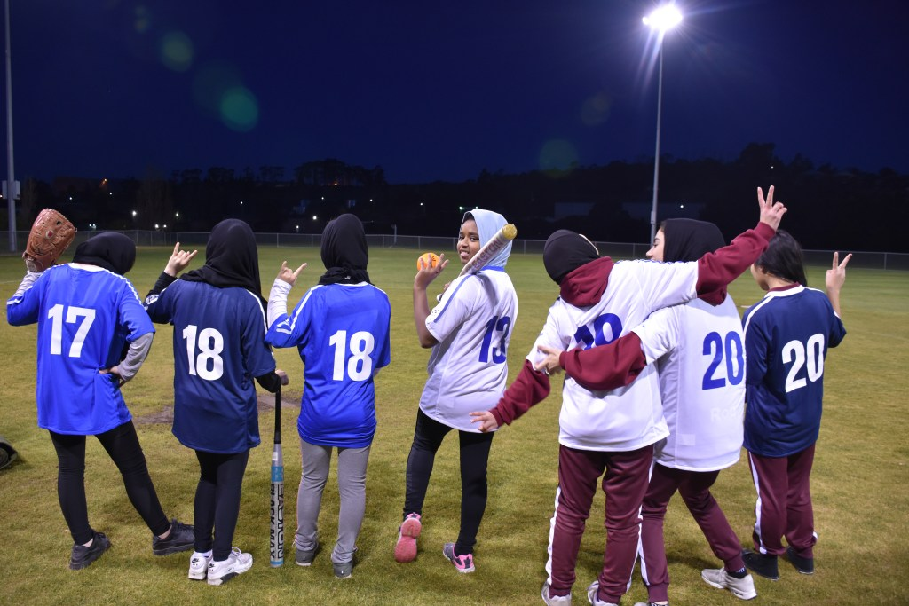 Picture of participants in wellbeing group at baseball pitch