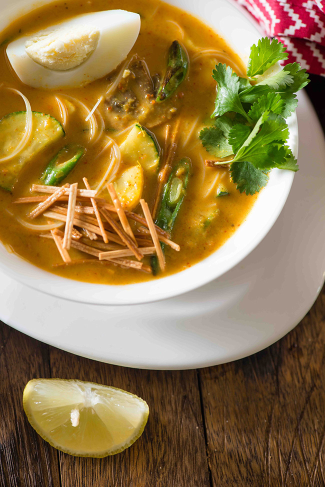 Khow Suey soup is a soup meal bowl inspired from Burmese noodle dish Ohn Khauk swe. The Burmese Khaw Suey Soup is vibrant in flavours, has lots of veggies and noodles cooked in coconut curry based soup.