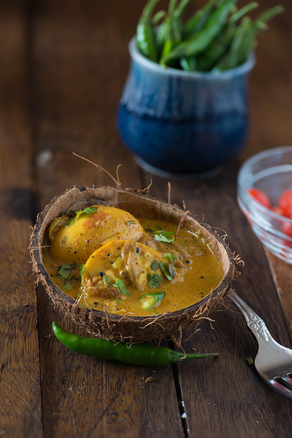 Kerala egg curry recipe, quick and easy and spicy Kerala style egg curry cooked in coconut milk. Also known as Nadan Mutta curry this is Authentic Hotel style Kerala egg curry which is served with Chapati, rice, malabar parotta, Idiyappam and appam.