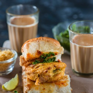 Vada Pav is one of the famous Mumbai street food and most favorite roadside snack. Mumbai vada pav can be called own desi Indian burger is a sandwich in which spicy vada with chutney is sandwiched in pav bun.