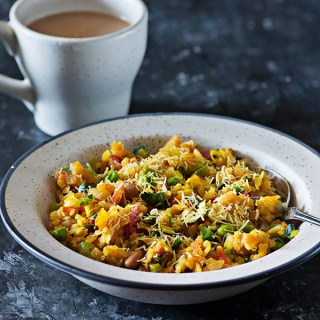 Vegetable Poha is popular and healthy Indian breakfast dish made with flattened rice and lots of vegetables. From as long as I can remember vegetable poha been a comfort breakfast or sometimes just a small portion of poha with evening tea was served as a part of Indian chai Nashta, especially during the weekends.