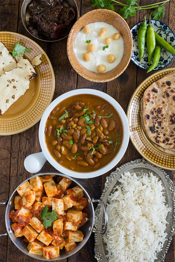Rajma Chawal a popular Punjabi dish is one of the healthy meal from Indian cuisine. Rajma masala recipe is easy, simple and fairly quick. Cooked rajma or kidney beans are cooked in onion and tomato based flavourful gravy and served with steamed Rice as a Rajma chawal meal.