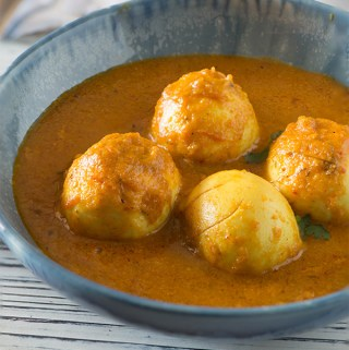 Egg butter masala is mildly spicy and rich curry. Boiled eggs in smooth vibrant makhani gravy is one of my favourite curry to serve with steamed rice. And, egg butter masala with Nan feels like heaven on my plate as well as palate