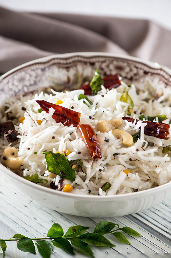 coconut rice recipe is fragrant, aromatic and one of my favourite side dish ! These days I make it in instant pot , electric pressure cooker any other pressure cooker. All It takes is 20Minutes. Cooked with fresh tender coconut and lots of aromatic, this is the perfect side dish for any Indian curry.