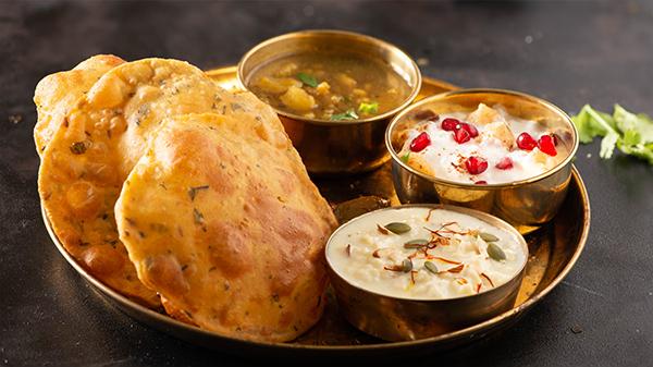 festive thali kheer poori aloo sabji