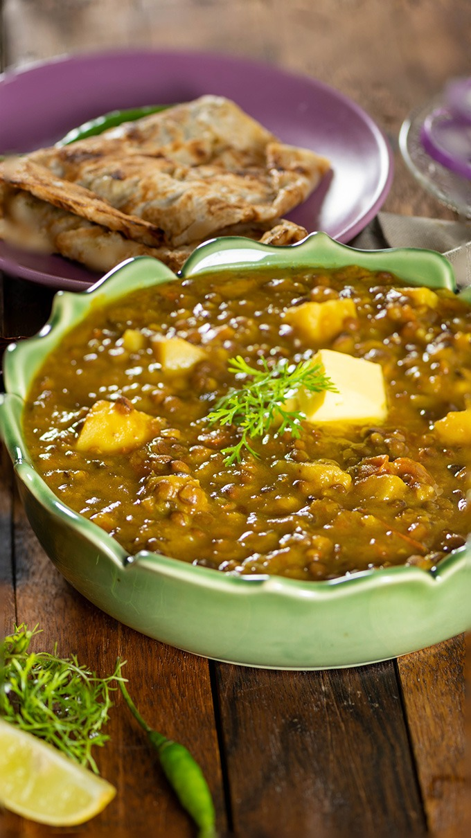 brown lentil curry with butter and naan