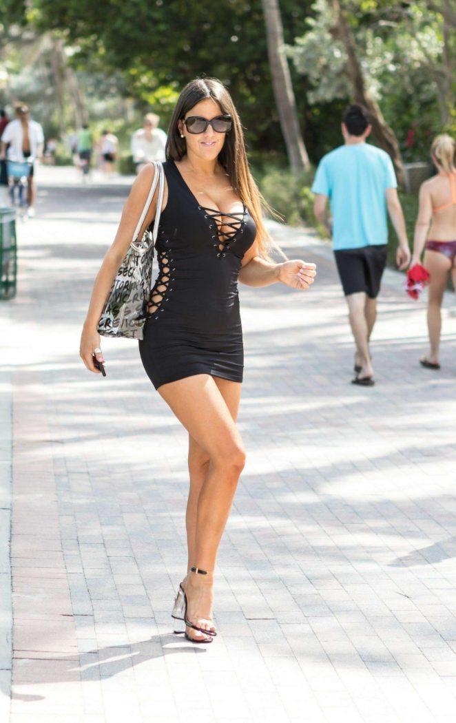 Claudia Romani in Black Mini Dress at South Beach in Miami