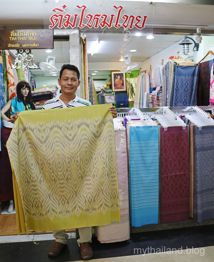 "A fabric store in the ""Silk Zone"" in Bangkok. The owner onced worked as a sericulturist for Jim Thompson in Korat. I purchased the bolt of mudmee silk that's being displayed for $90. A decent price."