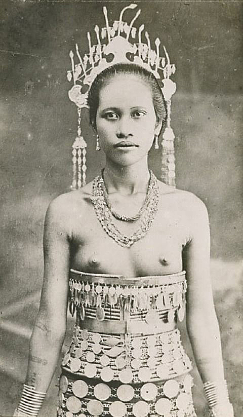 A Karen Hill Tribe Princess topless in traditional dress