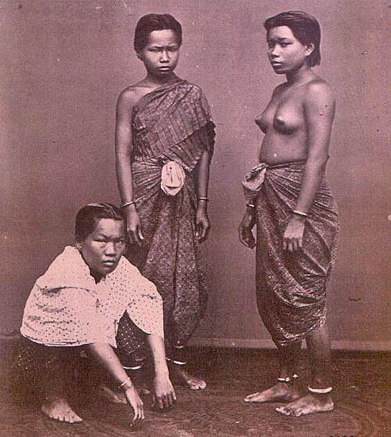 Topless Siamese Women wearing only a chong kraben.