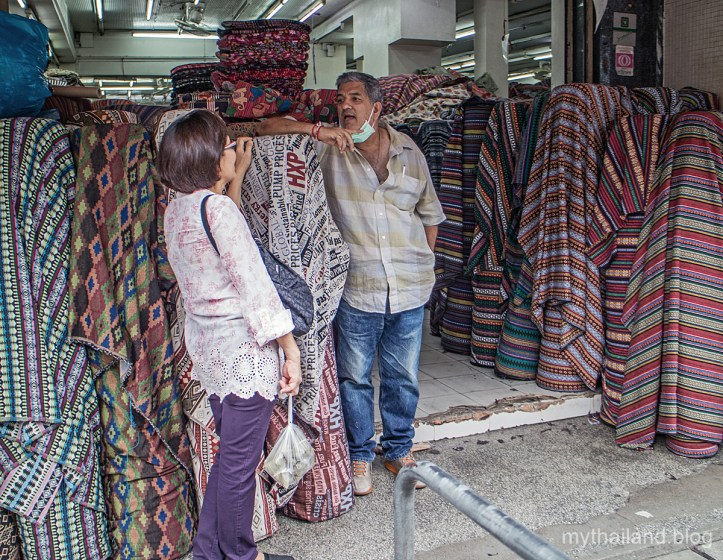 A fabric store owner in the Garment District of Chiang Mai