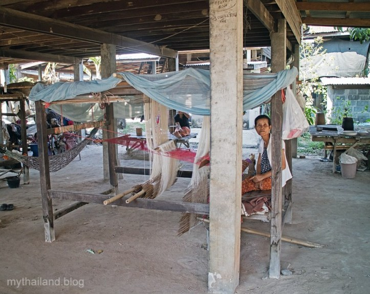 Thai weavers set up their looms under their houses.