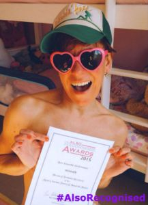 Anna-Jane Casey covers up (just) for her Best Ensemble Performance certificate selfie for Forbidden Broadway