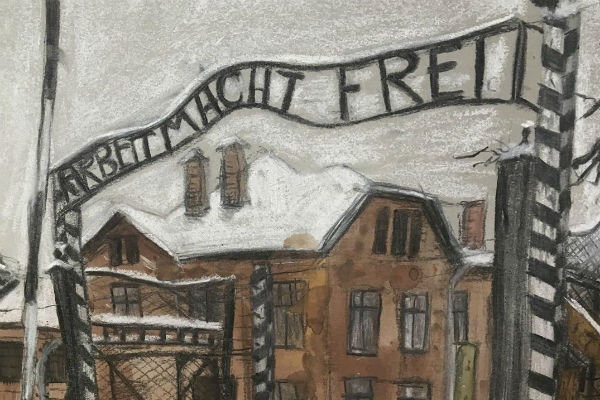 "A sign at Auschwitz concentration camp: ""work sets you free"""