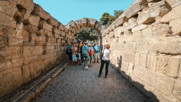 passing-through-a-stone-archway-you-enter-the-remains-of-the-ancient-stadium-gopr1837