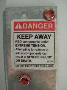 Garage door warning label