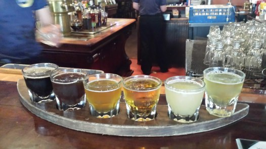 six different coloured beers