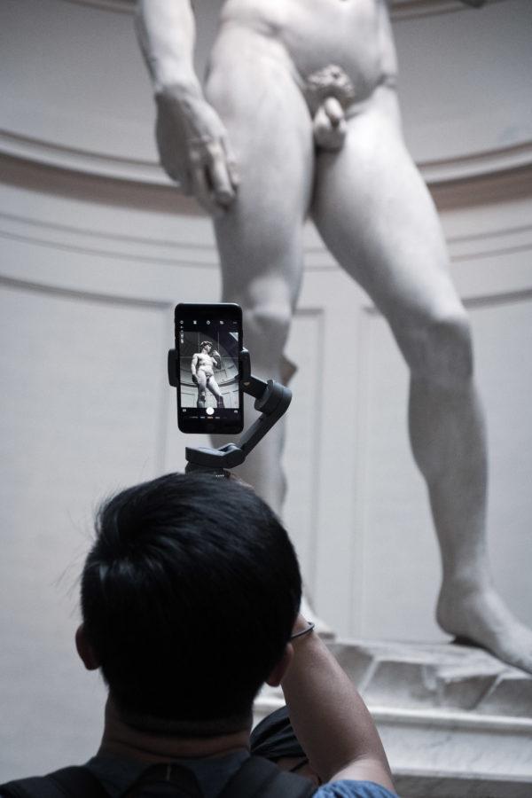 Man taking pictures of Michelangelo's David