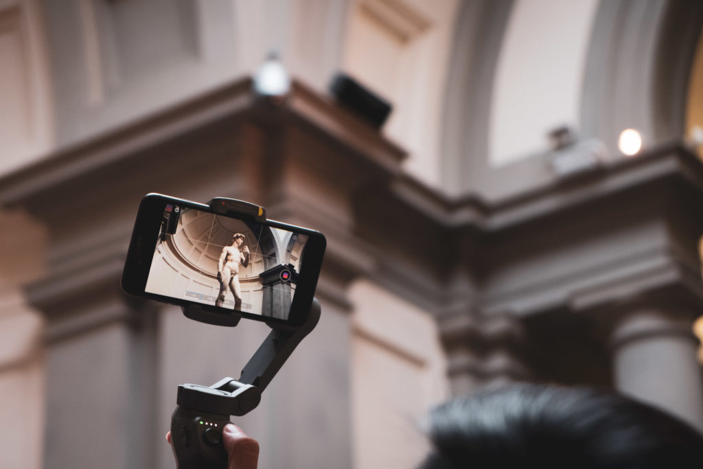Visitors taking video of Michelangelo's David