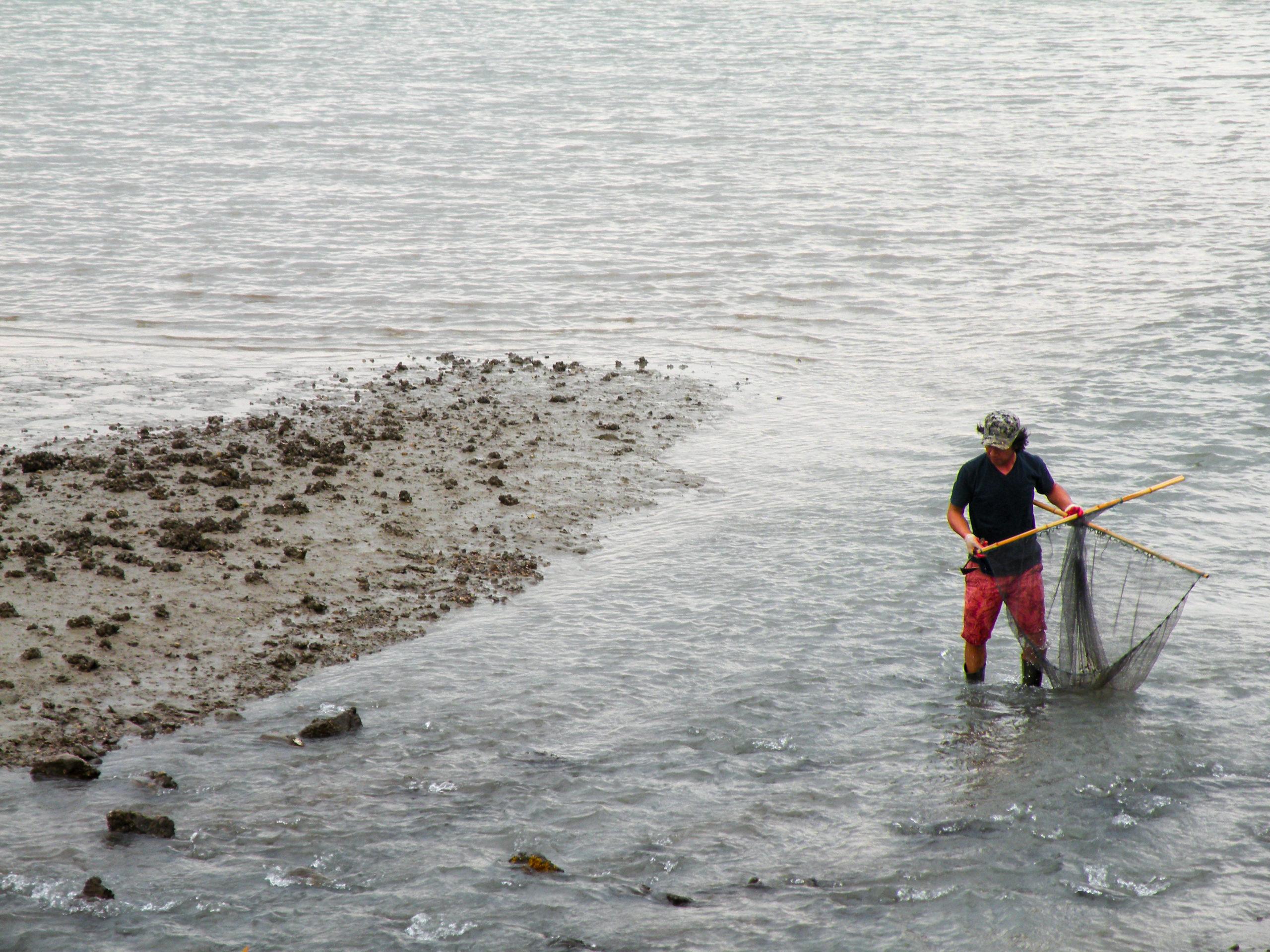 Korean man fishing on 가우도 (Ga-u-do)