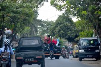 Motorbikes, cars, people, the traffic is non-stop...