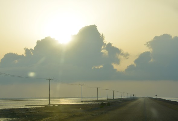 Early driving to the Oman coast, flat ,flat and more flat... the poles and cloud make the interest here...