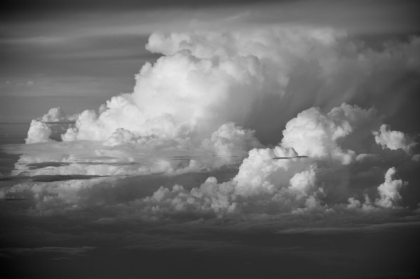 Cumulus high in the sky, over the Western Ghats, India, just before sunset, shot from the plane window....