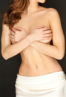 Atractive woman covering breasts