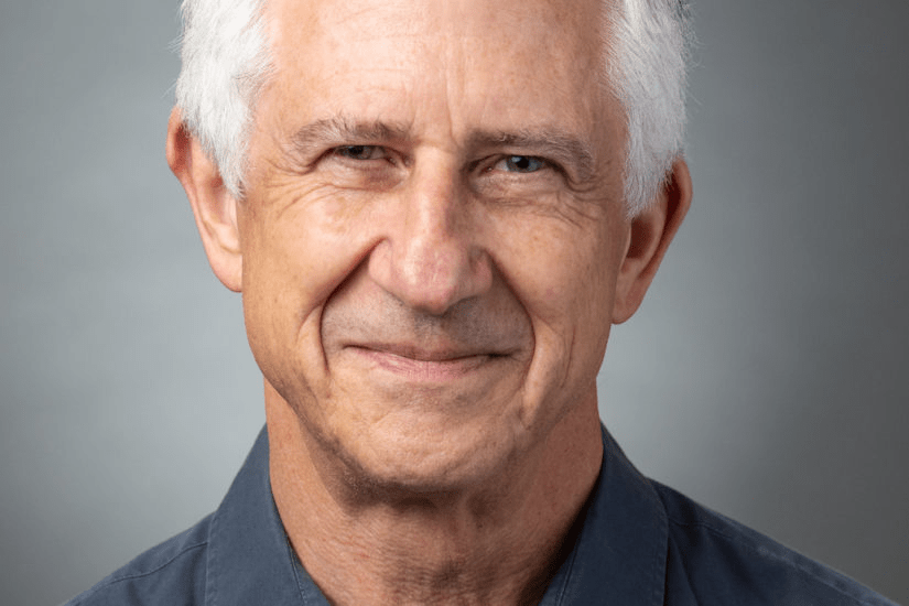 Paul Adler, member of USC's Working Group on University Culture, whose mission is to change culture at the university, photographed in a headshot style photo, he is smiling and looking into the camera.
