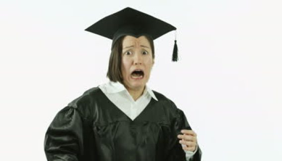 stock-footage-caucasian-girl-student-graduating-isolated-on-white-scared-frighten-screaming
