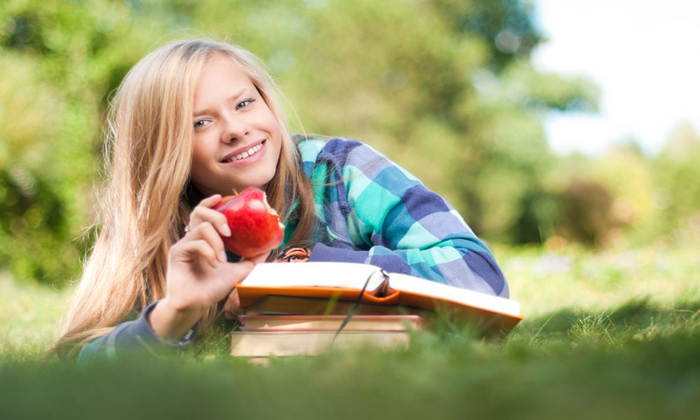 student girl with apple and books