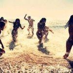 splashing friends at the beach