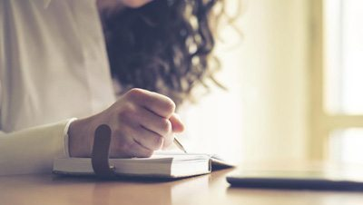 girl writing in her journal