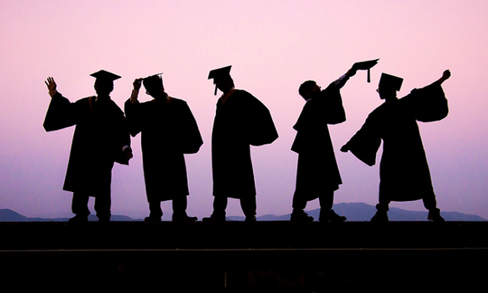 high school graduates celebrating