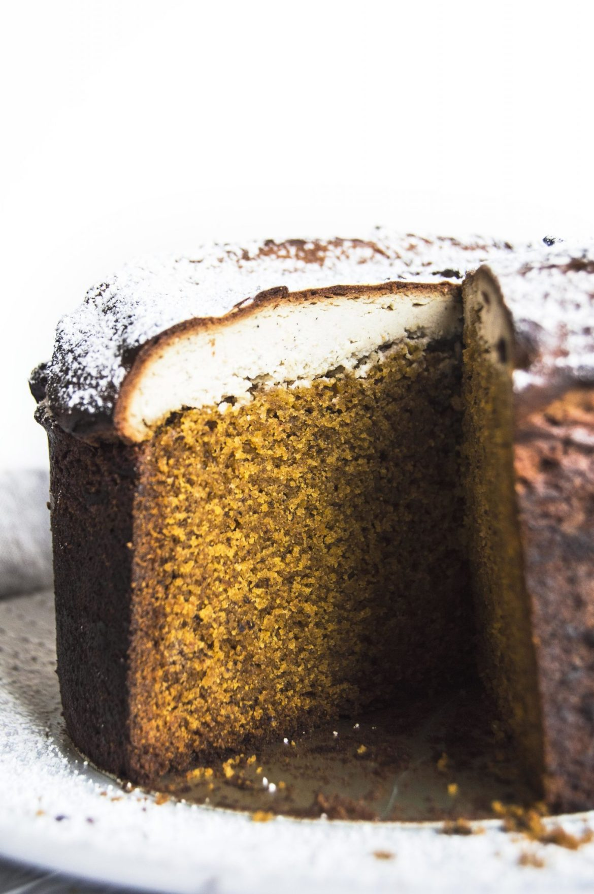 Vegan Pumpkin Zesty Orange And Crushed Black Pepper Cake With Cardamom Cheesecake Topping