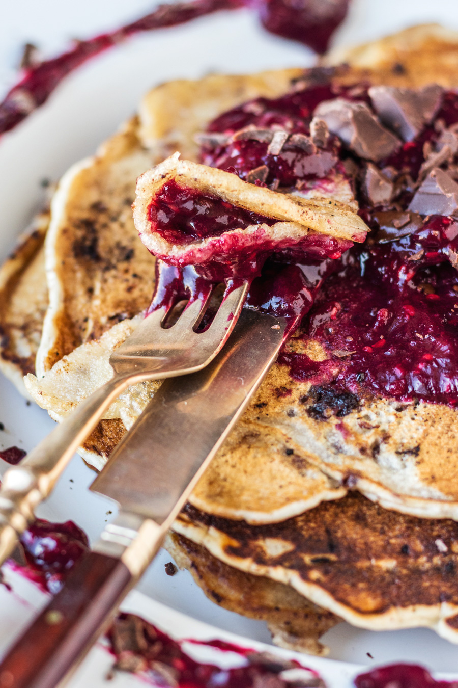 Vegan Chocolate Chip Pancakes With Smooth & Zingy Mixed Berry Sauce