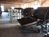 The carding machine was used to intertwine the wool fibers, forming a kind of webbed batting. The batting was then divided into ropes, called roving, which were taken to the spinners and the spinning machines.