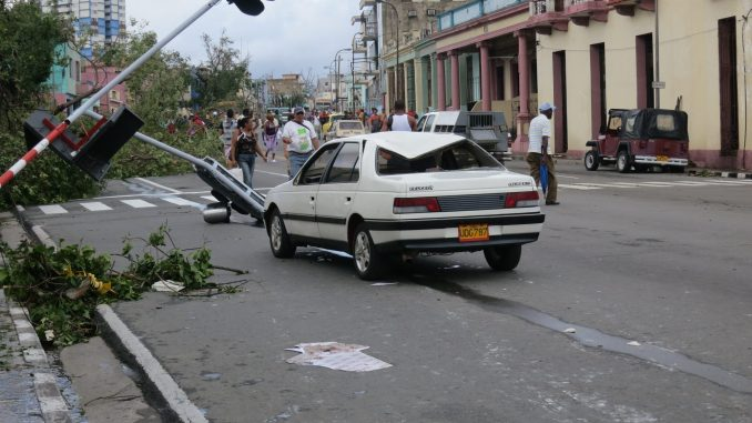 Damaged Cars and traffic lights ripped off their base