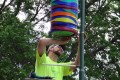 """David Himsel of the City of Whitewater adds some character to Main Street by hanging the barrel """"Wateryism"""" by Derek Hambly."""