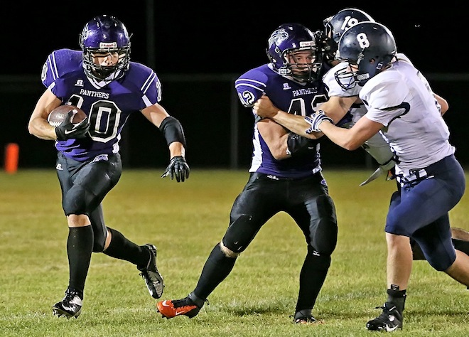 Palmyra-Eagle's Zach Kiehl runs around a block provided by teammate Brett Knoebel during Friday's 34-7 loss to Clinton. Knoebel had 69 yards rushing on the game. (Photo by Bob Mischka)