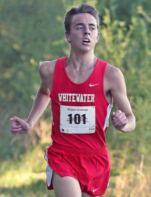 The Whippets fared well in their home invitational cross country meet, held at UW-Whitewater Sept. 13. Senior Brett Harms, right, won the race with a time of 17:17.7. (Photo by Peter Mischka)