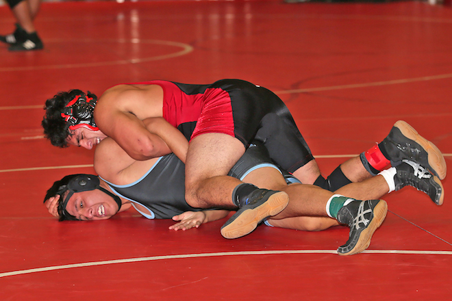 Ernesto Magana wrestles his way to a second-place finish at Whitewater High School's Wrestling Invitational Dec. 10. As a team, WHS finished fifth. (Bob Mischka photo)
