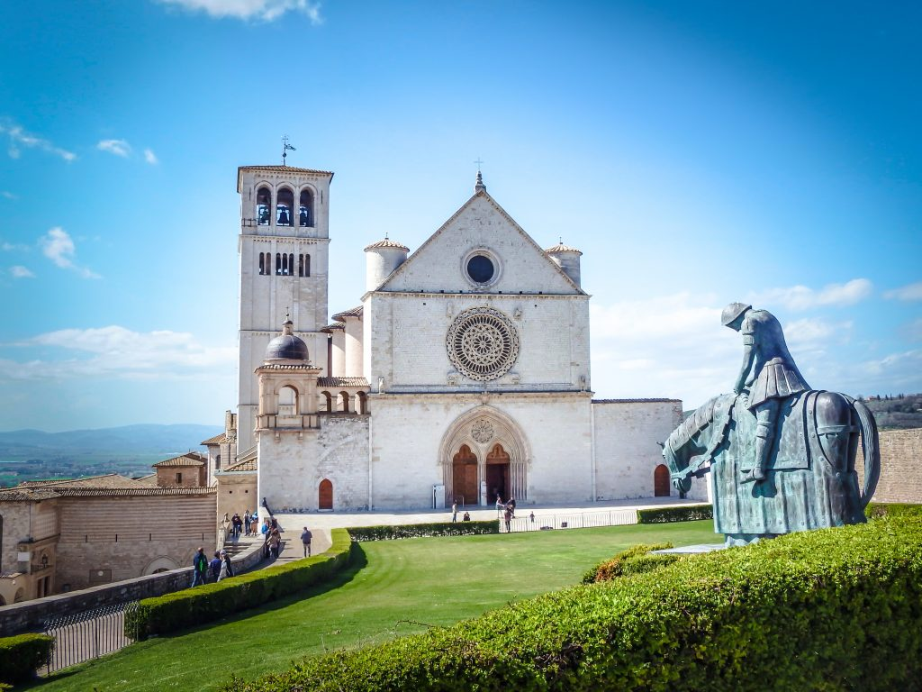 The Basilica of St. Francis on a hill above this this small Umbrian town during a day trip to Assisi, Italy