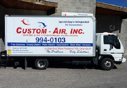 Flat roof heating and air conditioning duct system.