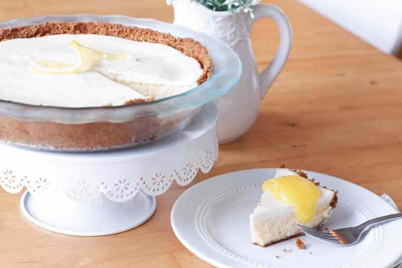 best lemon cheesecake slice on plate with lemon curd on top