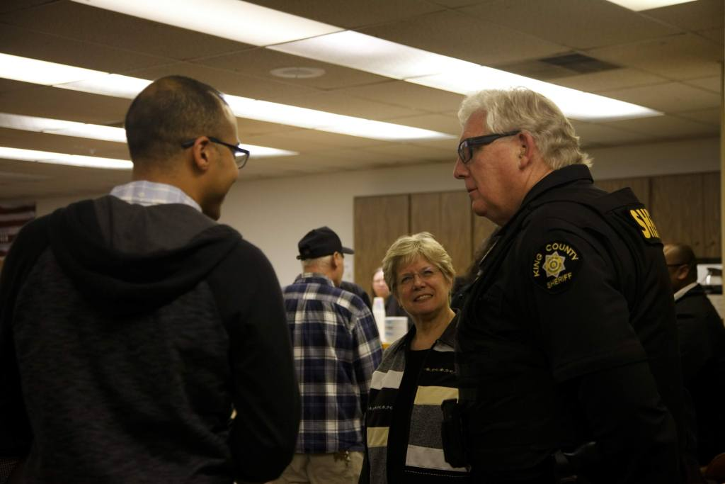 West Hill Community Association Board President Jeremy Williams (left) chats with Skyway Water & Sewer General Manager Cynthia Lamothe (center) and King County Sheriff's Office Precinct 4 Operations Captain Rick Bridges (right) at Skyway VFW Post #9430 on January 15th, 2019 for WHCA's Winter Quarterly Community Meeting.