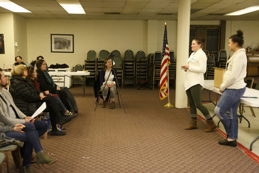 Tent City 3 Executive Committee Member Tricia Wood (left) and Fin Hardy of Lakeridge Lutheran Church give reports at Skyway VFW Post #9430 on January 15th, 2019 for WHCA's Winter Quarterly Community Meeting.