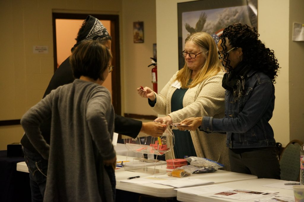 West Hill Community Association Vice President Margie Lindberg and Board Member Jacqueline Frazier draw winning tickets for gift card door prizes at Skyway VFW Post #9430 on January 15th, 2019 for WHCA's Winter Quarterly Community Meeting.