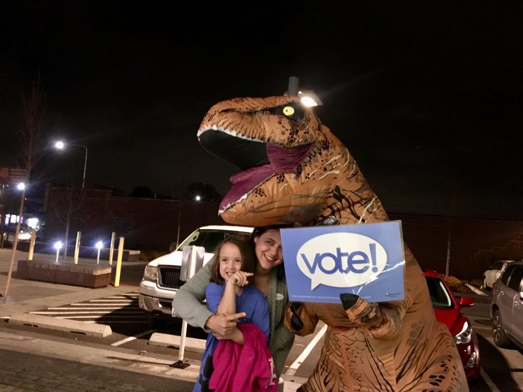 West Hill Community Association - T-Rex Gets Out the Vote at 2018 Midterms Election Day Assistance at Skyway Library