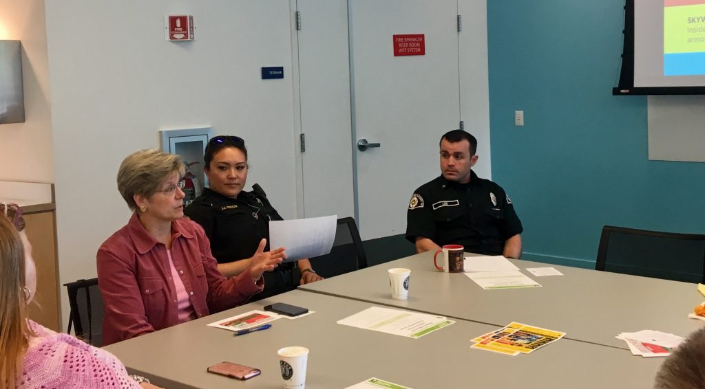 Skyway Water & Sewer General Manager Cynthia Lamothe, speaking at WHCA's Spring 2019 Community Coffee Hour at Skyway Library (left of KCSO Deputy Jen Eshom and KCFD20 Firefighter Mat Lee).